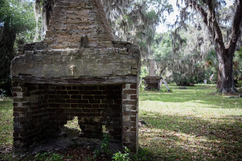 A series of brick chimneys on a historic site on Cumberland Island, one of many that were occupied by enslaved or formerly enslaved people.Credit...Stephen B. Morton for The New York Times