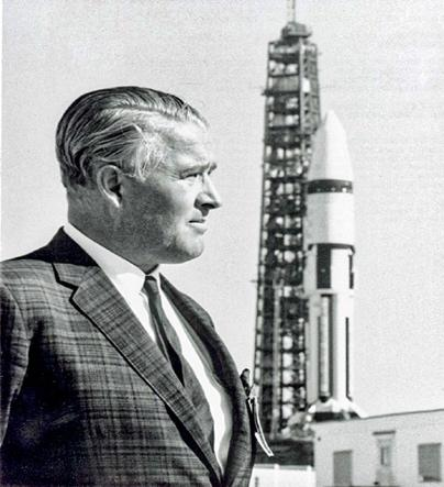 A person standing in front of a tall tower Description automatically generated with low confidence Wernher von Braun, former Nazi scientist at Huntsville facility in Alabama. [Source: encyclopediaofalabama.org]