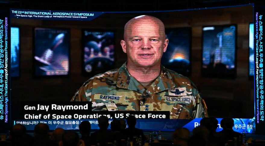 """Chief of U.S. Space Operations Gen. John W. ``Jay"""" Raymond speaks in a video message screened during the 22nd International Aerospace Symposium at Grand InterContinental Hotel in Seoul Oct. 18. Credit: ROK Air Force"""