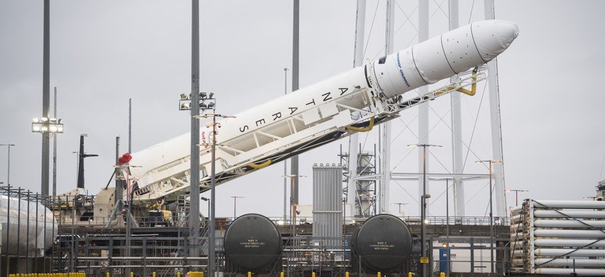 An Antares rocket carrying a Cygnus resupply spacecraft is raised into a vertical position at NASA's Wallops Flight Facility in Virginia, February 5, 2020. Aubrey Gemignani / NASA via Getty Images