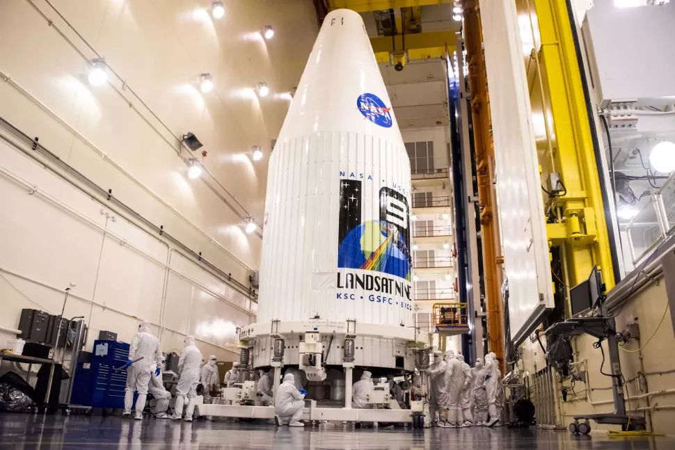 NASA's new Landsat 9 Earth-observation satellite is secured inside its payload fairing for a planned September 2021 launch into orbit on a United Launch Alliance Atlas V rocket from the Vandenberg Space Force Base in California. (Image credit: USSF 30th Space Wing/Chris Okula)