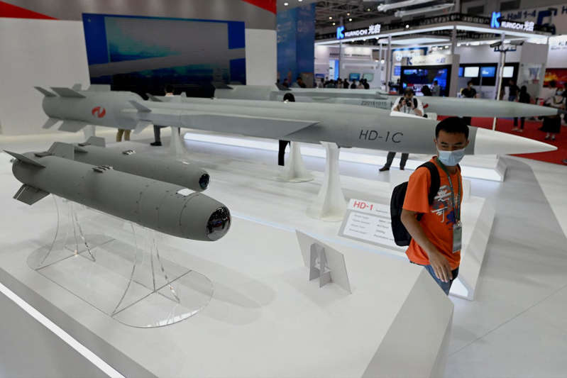 © AFP via Getty Images File. A man walks among supersonic cruise missiles at the 13th China International Aviation and Aerospace Exhibition in Zhuhai