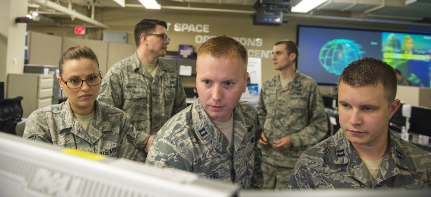 Airmen of the Joint Space Operations Center monitor computer systems designed to detect, track, and identify all artificial objects in Earth's orbit at Vandenberg Air Force Base, Calif., in 2014. U.S. Air Force / Airman 1st Class Krystal Ardrey